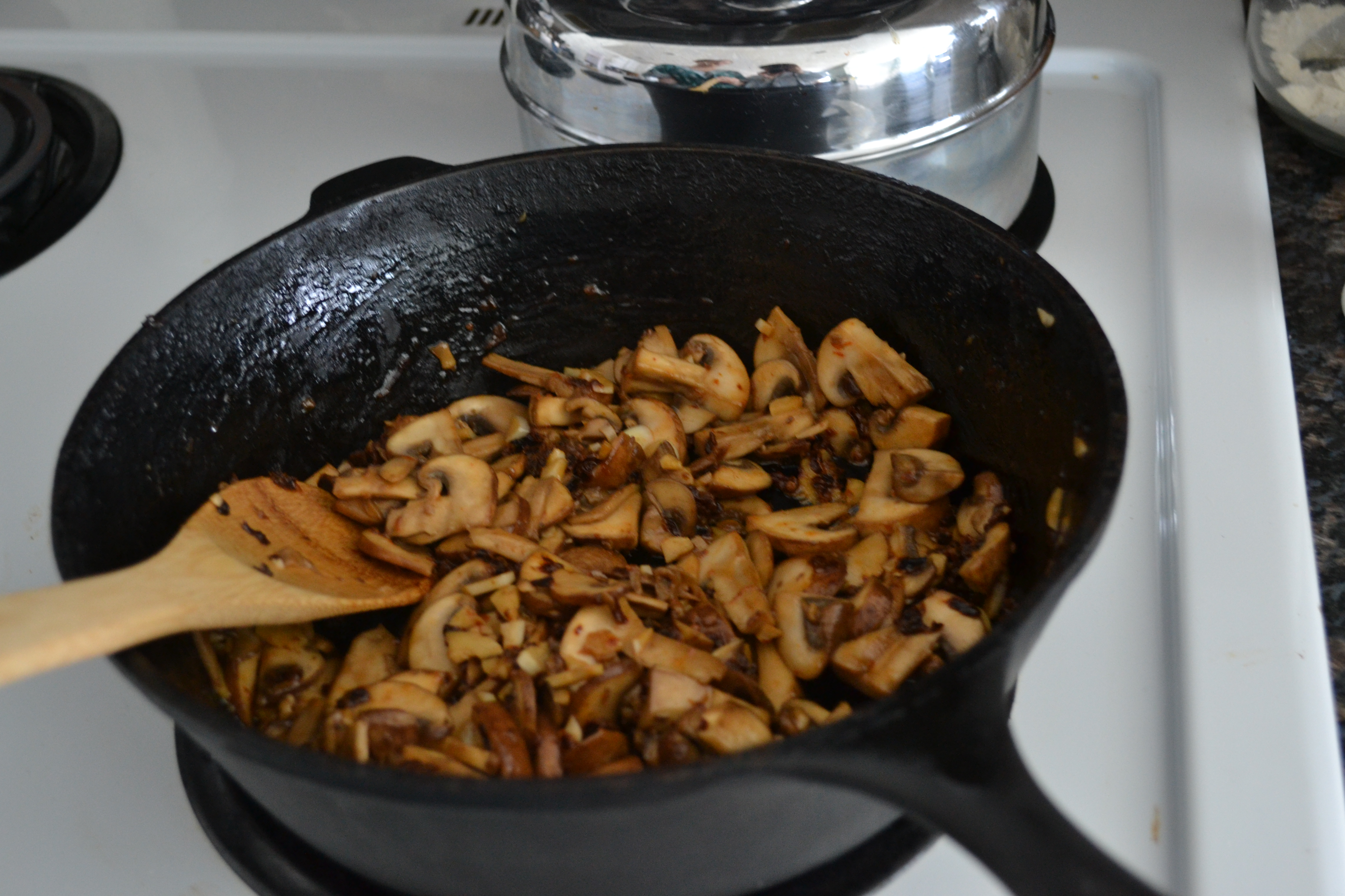 In a cast iron skillet, saute mushrooms in olive oil and butter ...